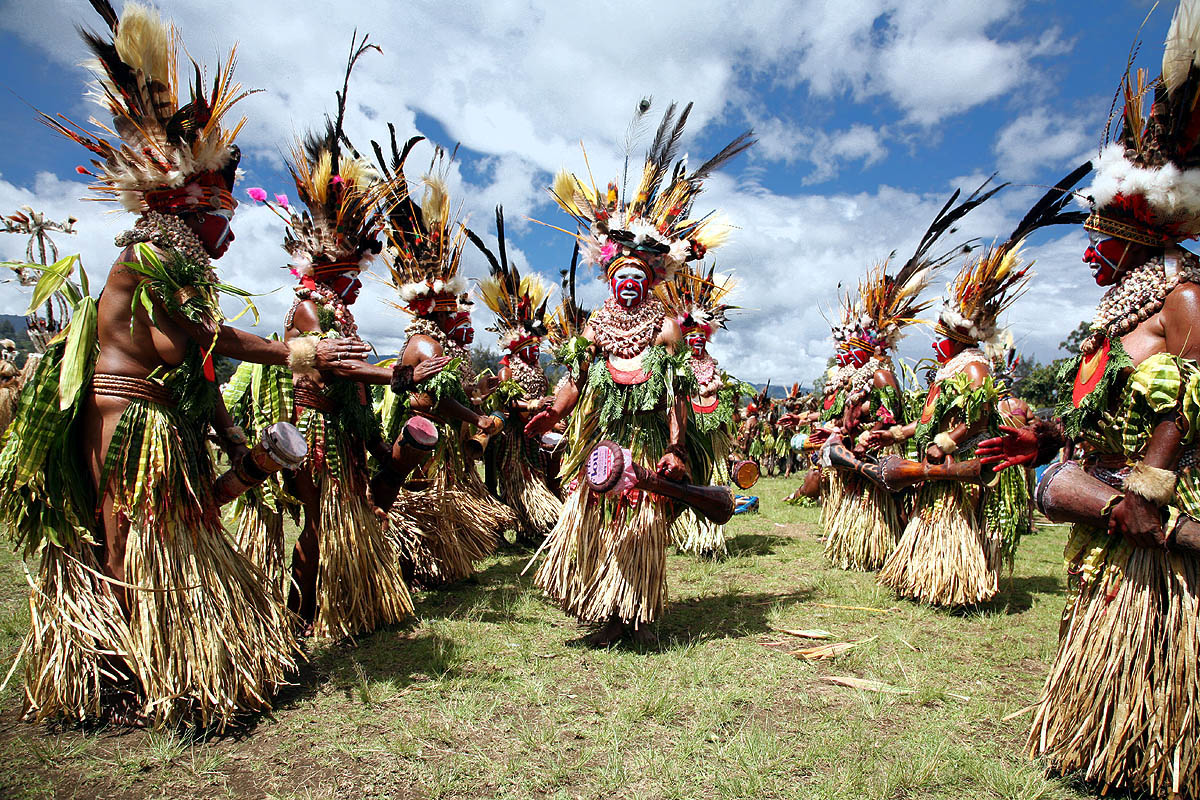 Performers in a sing-sing gather in Wabag, Enga Province of Papua New Guinea. These gatherings typically constitute multiple different tribes and are always bursting with various art forms, from decorative body adornments, to the dance, song, and musical drum lines.