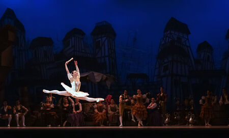 Music and dance from more stratified societies tend to feature explicit soloists and solo acts. Ballet, for example, typically includes a strict hierarchy of roles, as pictured above with a soloist spotlighted in the foreground while the background dancers are visible behind her.