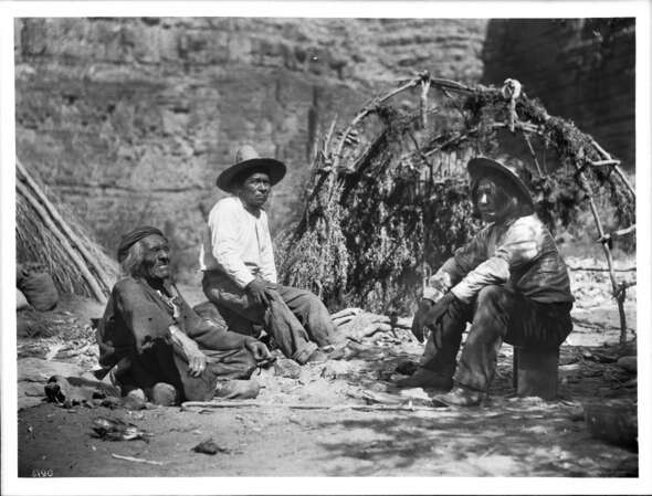 A Havasupai elder (pictured on the left) tells stories to two other men as they gather around a campfire, ca. 1899. The telling of stories and folktales is an important part of passing along aspects of culture.
