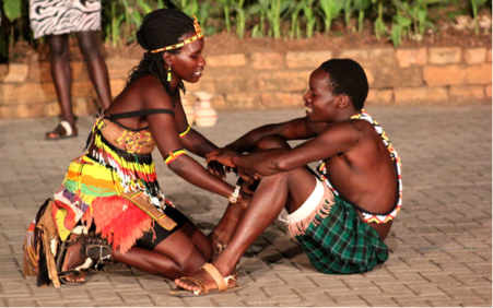 Courtship unfolds in the Ndere Cultural Center in Kampala, Uganda.
