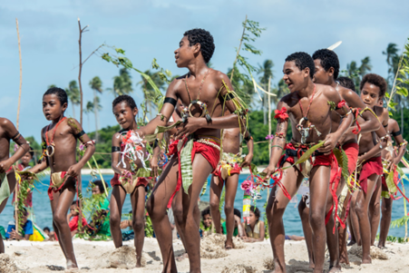 Young Trobriand men perform a celebratory dance before a game of cricket on Kitava Island in Papua New Guinea. These dances are known to be especially sexual, and geared towards the female spectators you can see watching just beyond the performers