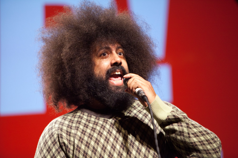 Reggie Watts performs on stage as the final presenter of PopTech 2011, on Saturday night