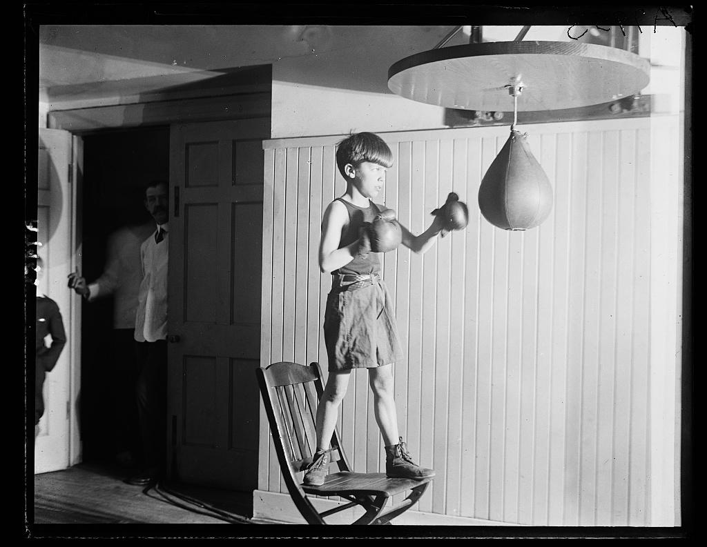 Theodore_Roosevelt_III_punching_bag
