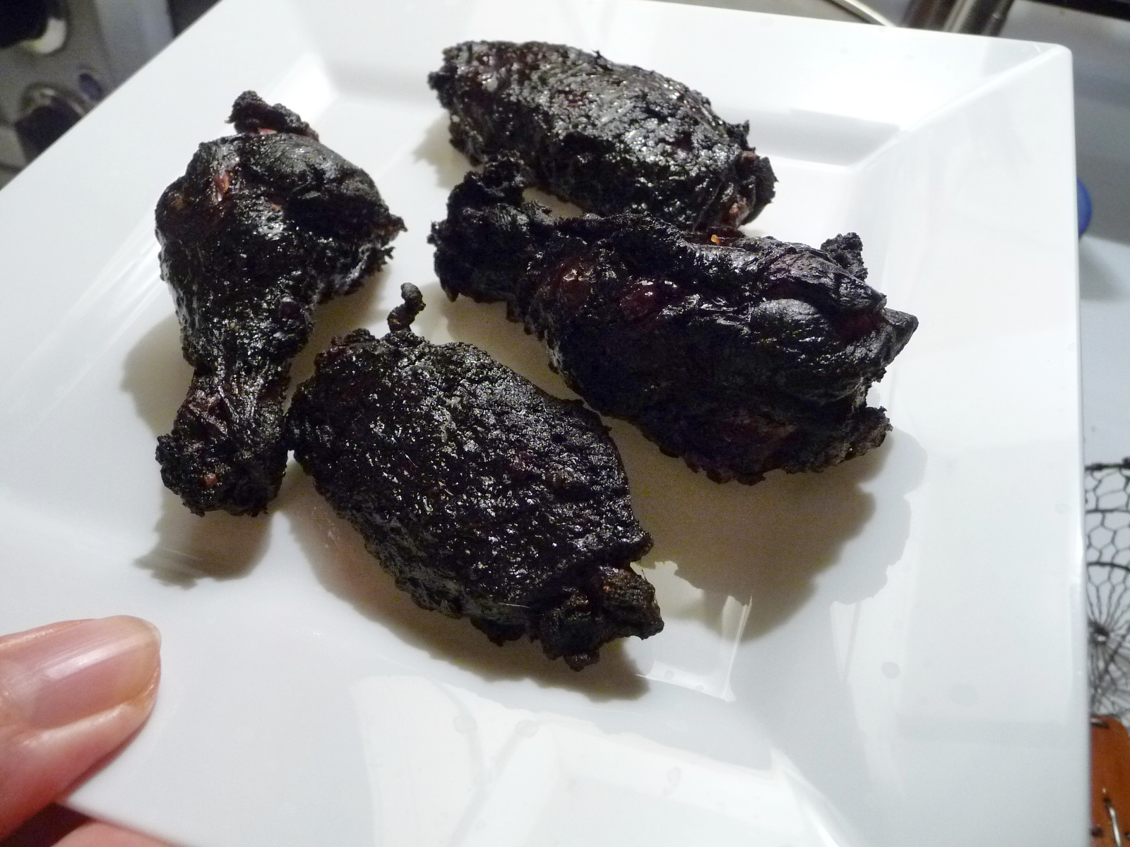 coal black wings after frying - a blank canvas