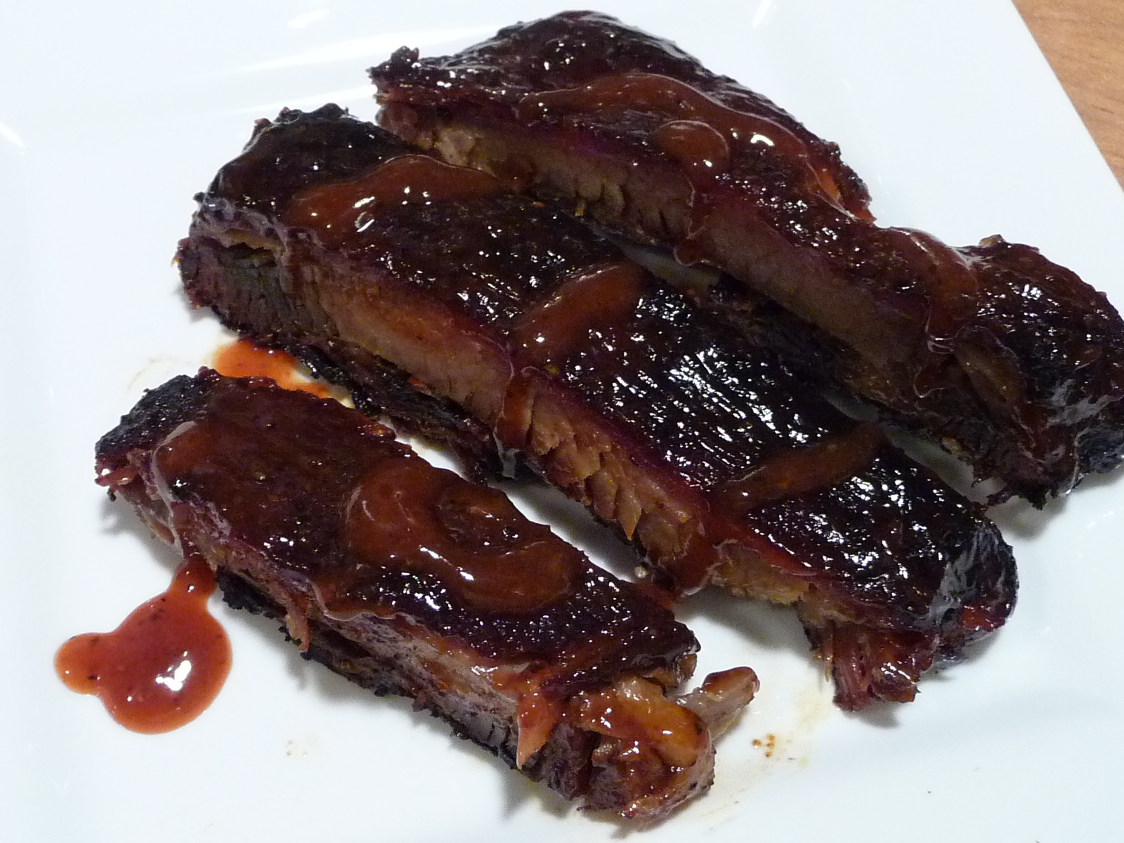 Smoked Ribs with Kramer's BBQ Sauce drizzled on