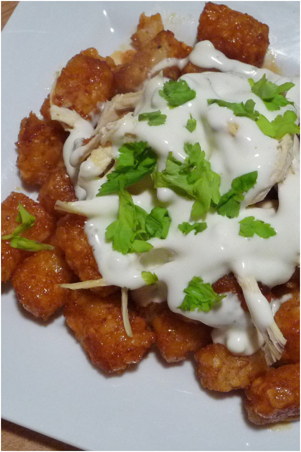 Tater Tots are tossed in Frank's Buffalo Wing Sauce, topped with shredded chicken, a good dollop of Blue Cheese Dressing and served as an appetizer. You may never eat Tater Tots the same way again!