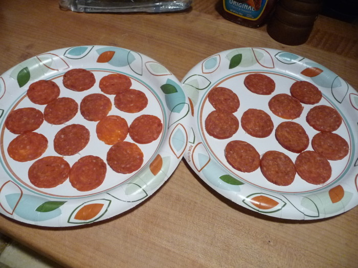 Sliced pepperoni on plates for microwave