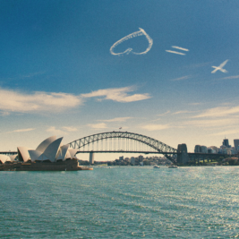 Cross Equals Love Easter Weekend | Screen Image | Background - Skywriting Zoomed Out Sydney Harbour