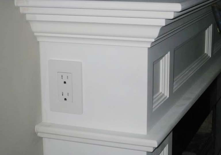 outlet on fireplace mantles