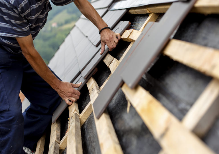 Hire a roof maintenance professional to repair and restore your roofing system.