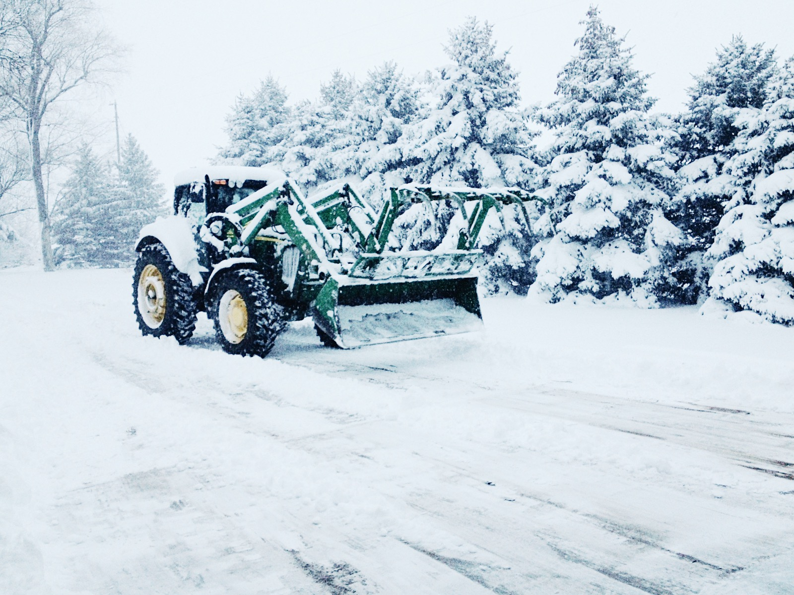 Plowing snow on the Greenway farm in the winter.