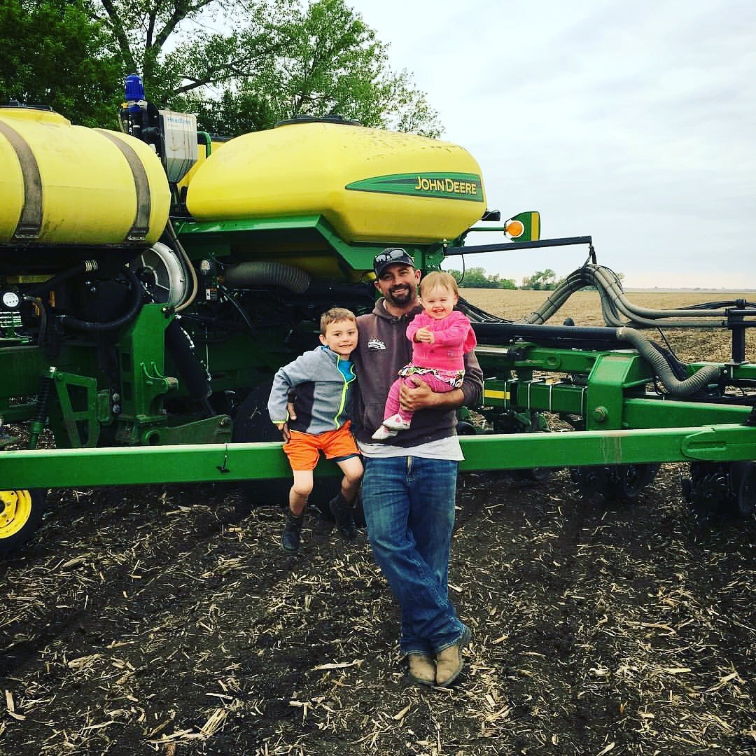 John Horter with his kids on their South Dakota farm.