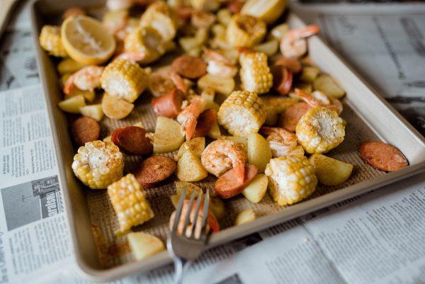 One pan shrimp boil with corn, shrimp, potatoes and sausage.