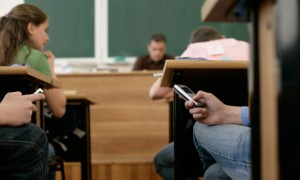 [5]students on cell phones in class