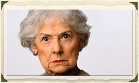 Picture frame of disapproving old woman.