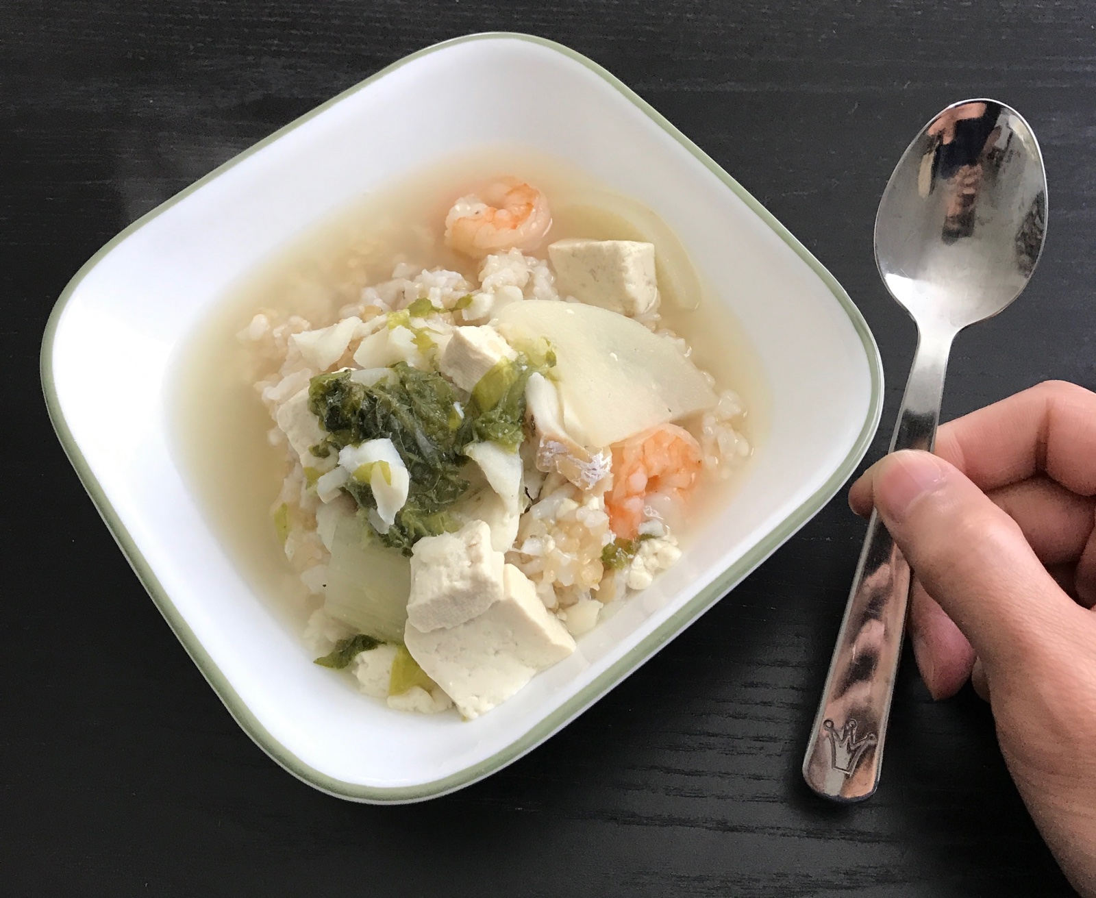 Bowl of soup with a kid's spoon