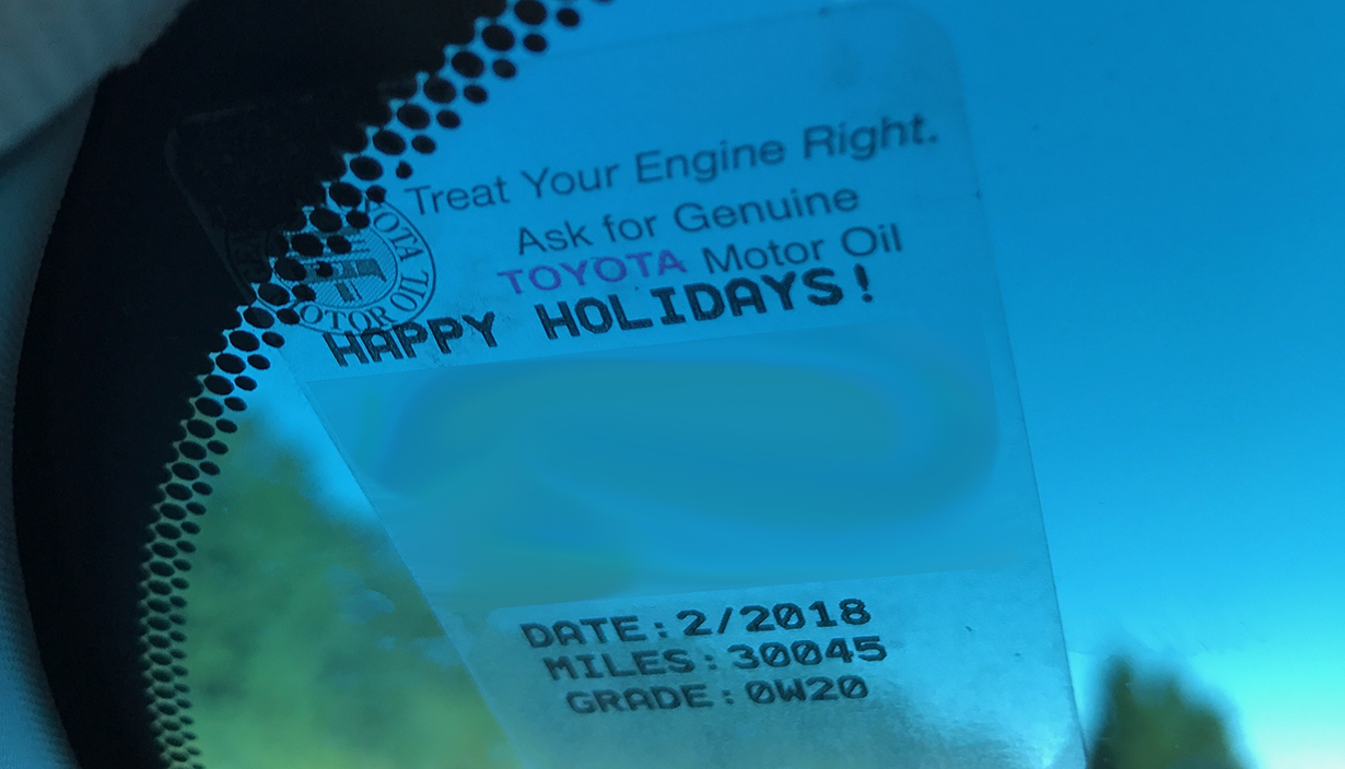 Reminder for oil change that says happy holidays