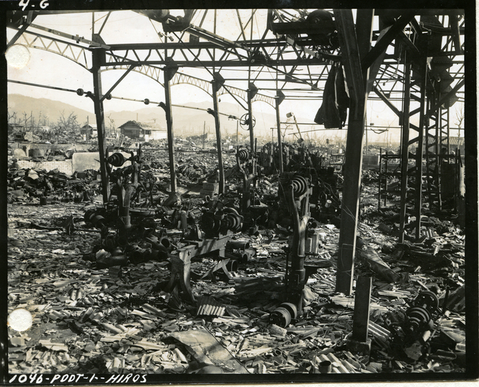 [Superficially blast-damaged stell-frame with fire-damaged tools, Isudashiki Pump Factory, Hiroshima]