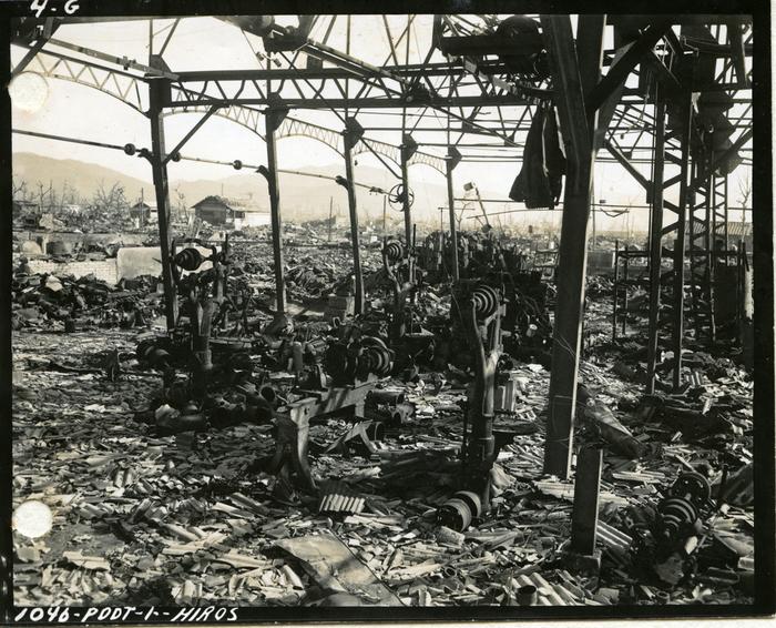 [Superficially blast-damaged stell-frame with fire-damaged tools, Isudashiki Pump Factory, Hiroshima]