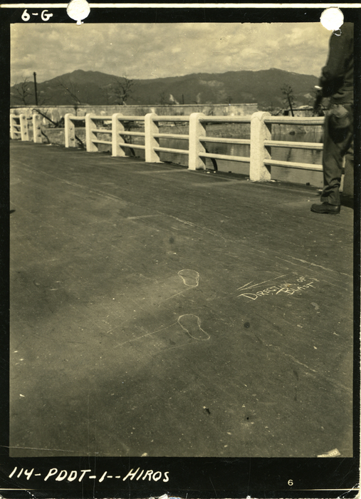 [Flash-burned asphalt on Bridge 20 over the Motoyasu River, Hiroshima]