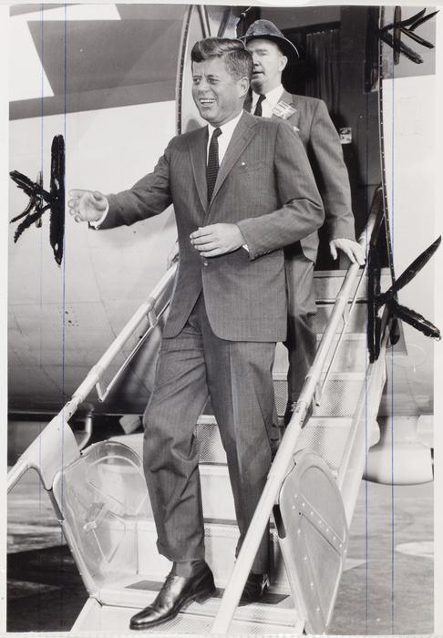 [John F. Kennedy disembarking from plane]