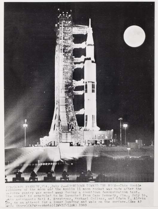 [Double exposure of the moon and Apollo11 moon rocket made after service gantry was moved away during countdown, Cape Kennedy, Florida]