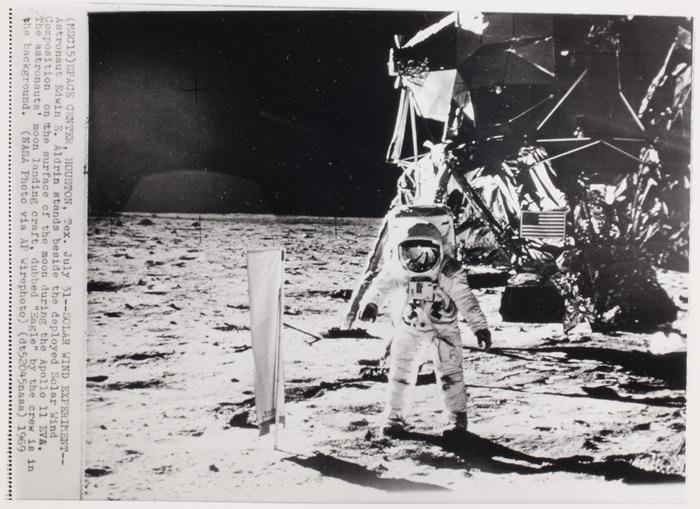 [Buzz Aldrin standing beside Solar Wind Composition on moon]