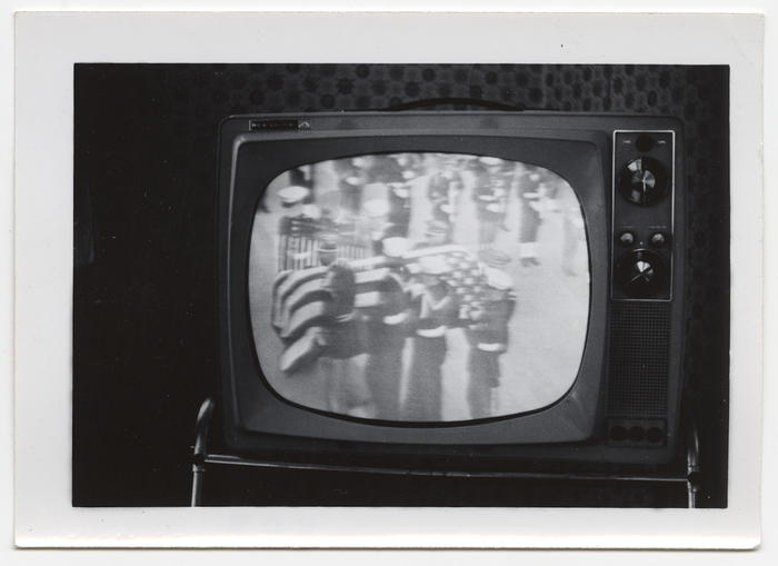 [Television image of John F. Kennedy's flag-covered casket]