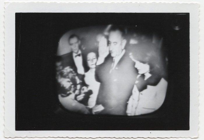 [Television image of Lyndon B. Johnson's swearing-in ceremony aboard Air Force One]