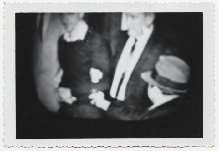 [Television image of John F. Kennedy's accused assassin Lee Harvey Oswald being transported to county jail moments before being fatally shot by Jack Ruby]