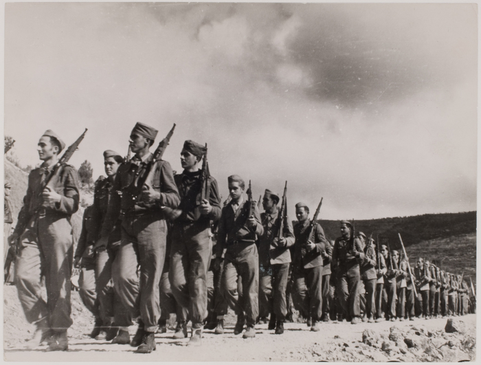 [Marching soldiers in farewell ceremony for the International Brigades, near Falset, Spain]