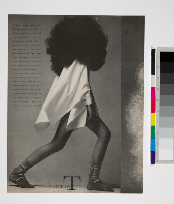 [British Model Penelope Tree stalks in profile beneath a giant Afro and moccasin inspired footwear]