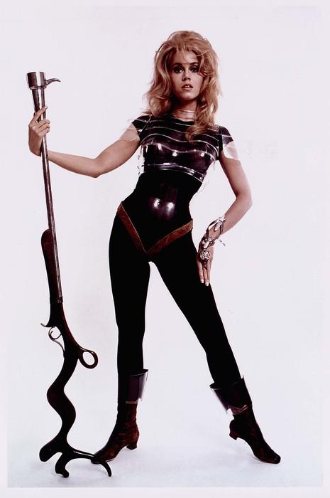 [Jane Fonda wearing space-age costume in publicity still for Roger Vadim's film