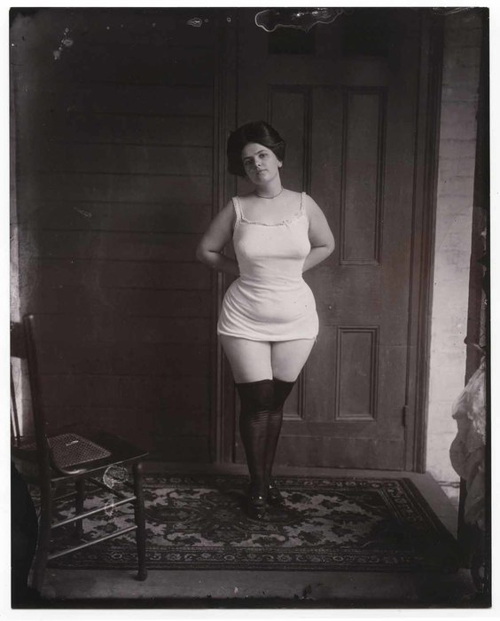 [Woman standing in underwear]