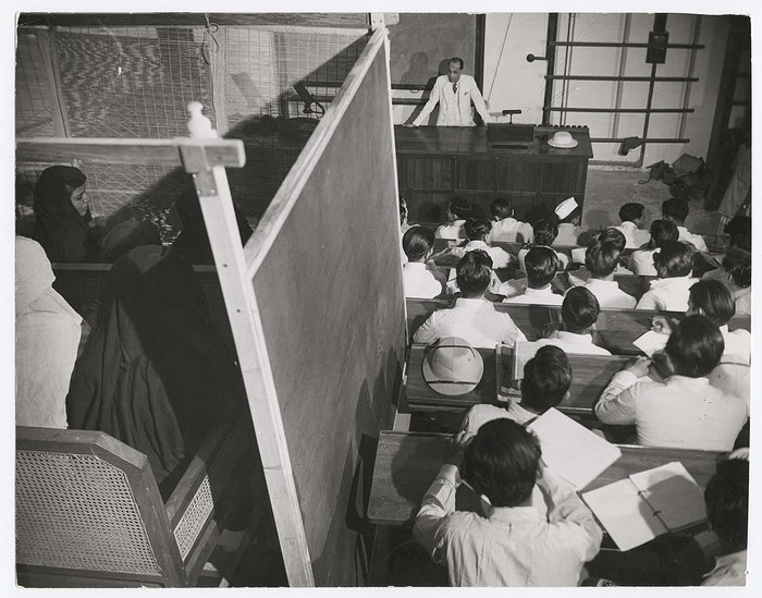 [Zoology classes divided with female students sitting behind a purdah screen as their male counterparts sit in the open at Aligarh Muslim University of Aligarh]