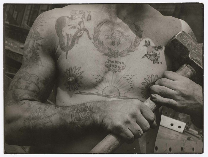 [Heavily tattooed chest and arms of workman at the Bethlehem Ship Building Co.]