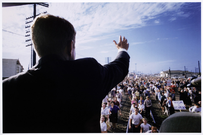 [John F. Kennedy waving to supporters from the back of his campaign train, Richmond, California]