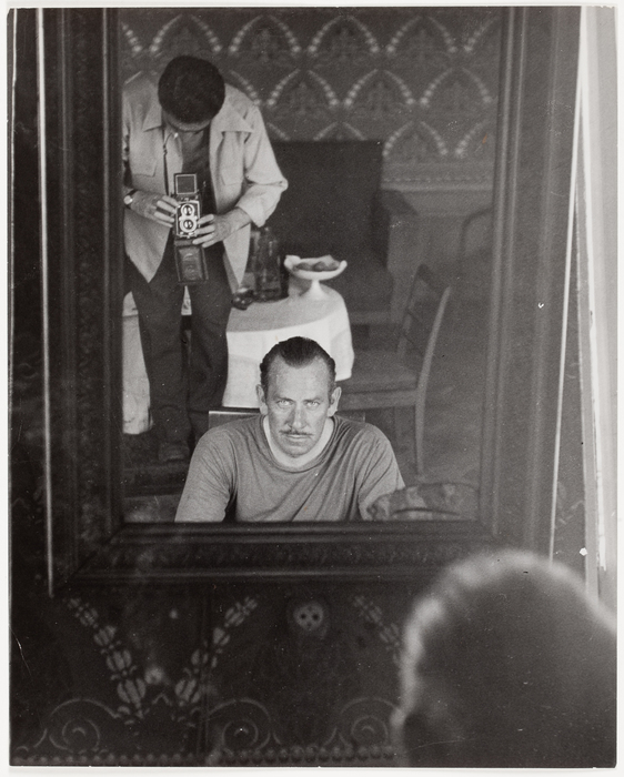 [Robert Capa photographing John Steinbeck through a mirror, Moscow, USSR]