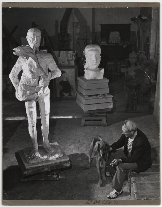 [Pablo Picasso with his Afghan dog called Kazbeck in his studio on the rue Grands Augustins, Paris]