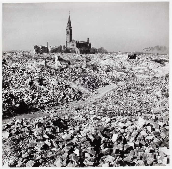 [The Catholic church between bricks from the destroyed Jewish Ghetto, Warsaw, Poland]