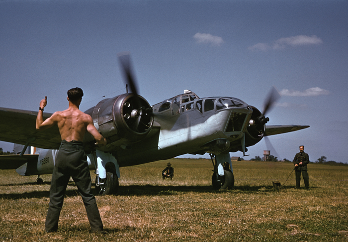 [A mechanic signals for takeoff to an Allied pilot before a raid over Occupied France, England]