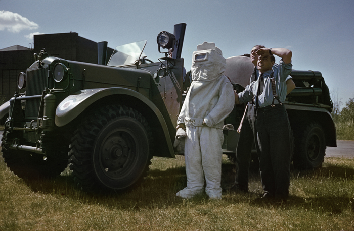 [Rescue squad in asbestos suit waiting for damaged plane after bombing raid over Occupied France, England]