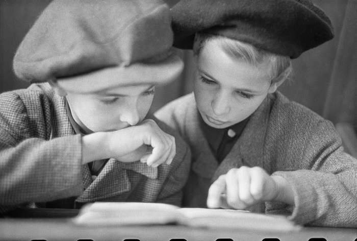 [Two orphaned boys, Henry and Fred Taucher, at the first Rosh Hashanah service held in the city since 1938, Fraenkelufer Synagogue, Berlin]
