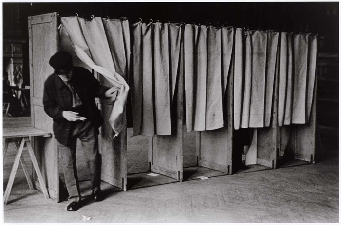 [Man voting in the election run-offs that would put into power the leftist-liberal Popular Front coalition government, Saint-Denis, France]