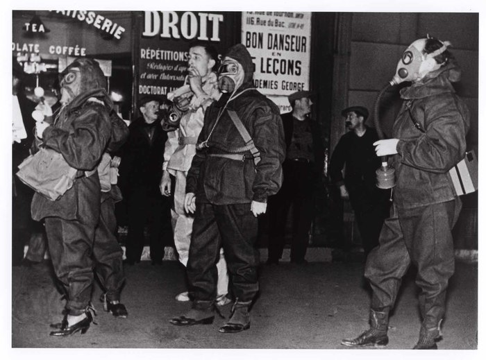 Men in gas masks and protective suits during a civil-defense drill