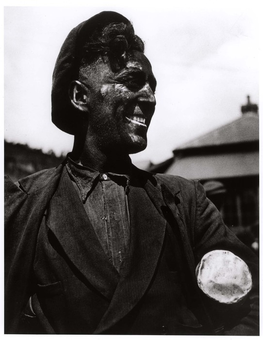 [Smiling coal miner in the area where