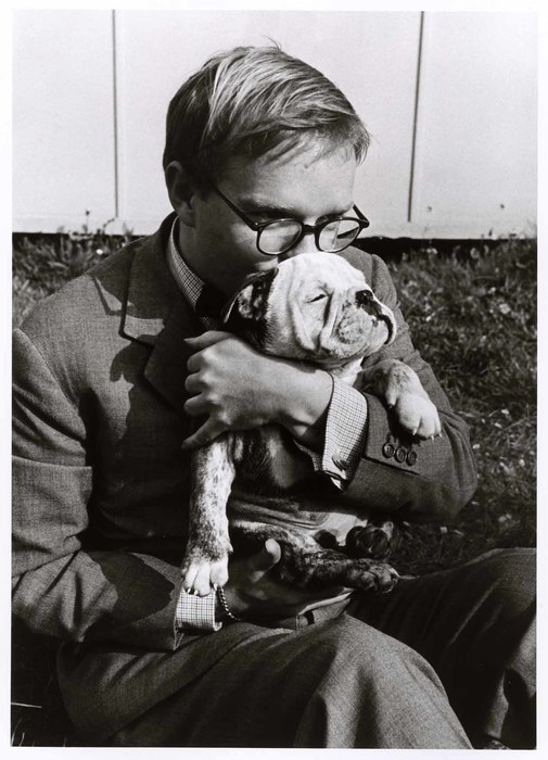 [Truman Capote holding a pet dog, Italy]