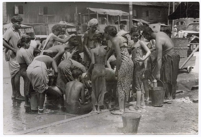 When Rangoon water supply was blown up the rebels, water was scarce for 5 days in the city, and the people crowded round fire hydrants, trying to drain the last drops into their pails.