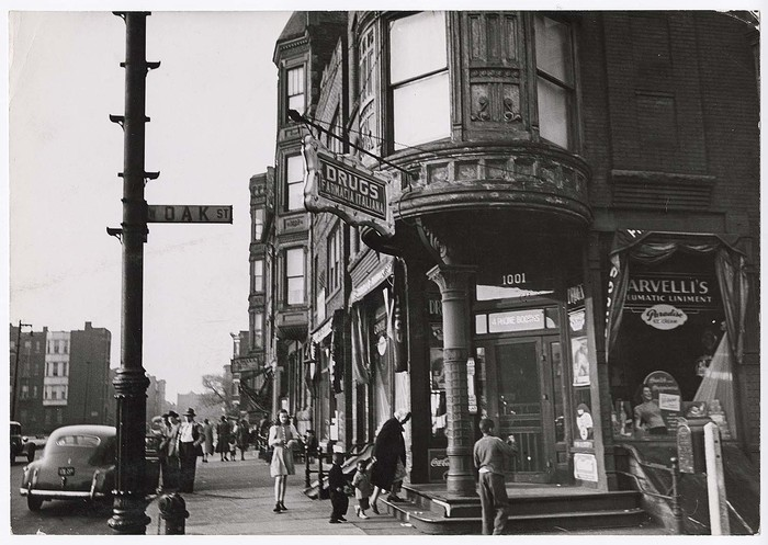 [Corner drugstore and pedestrian traffic on W. Oak St. in the Italian section of the Chicago]
