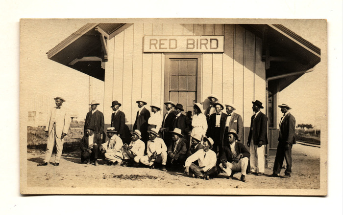 [Townspeople of Red Bird, Oklahoma, in front of railroad depot]